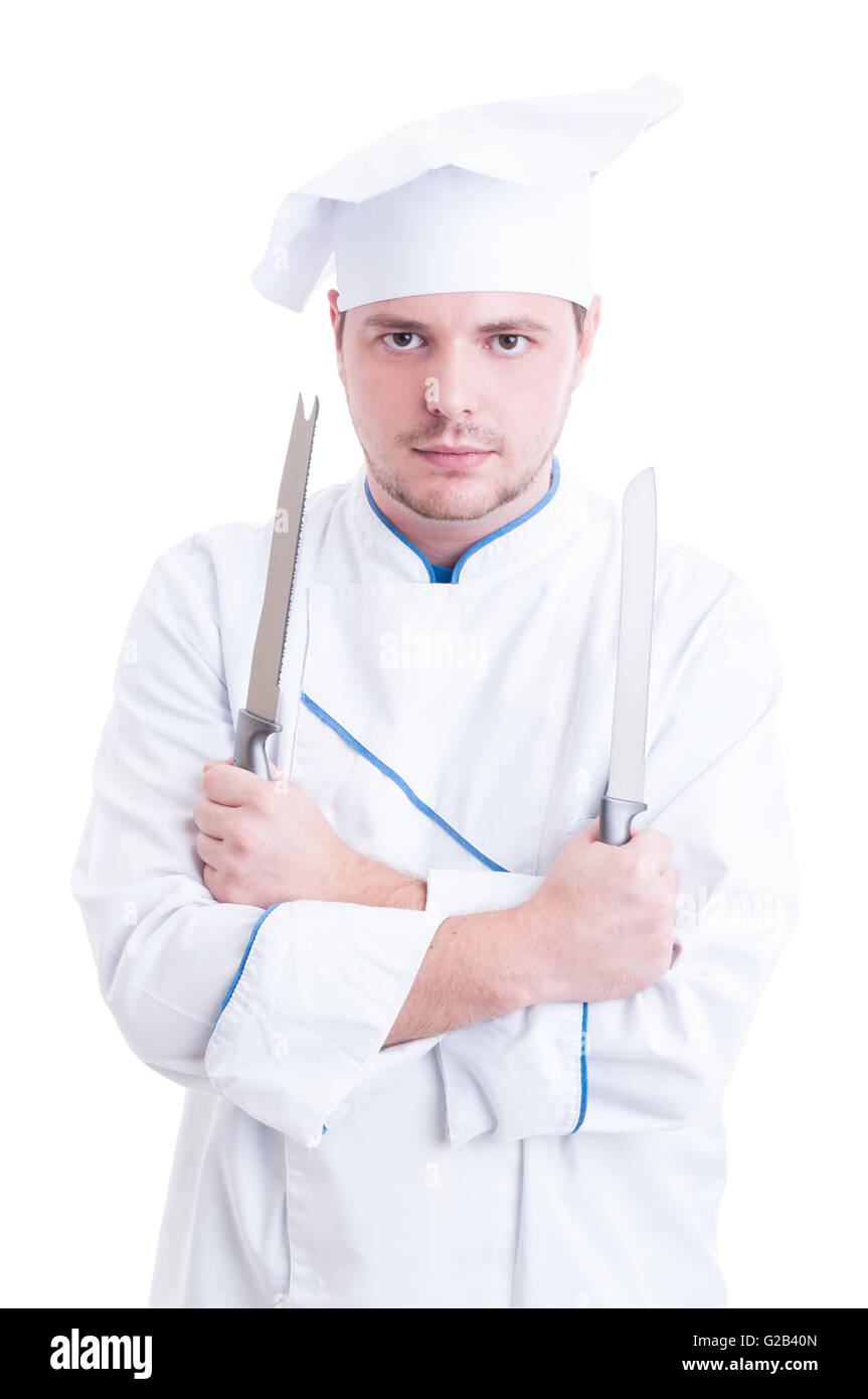 Skilled chef or cook holding two knifes or blades isolated on white - Stock Image