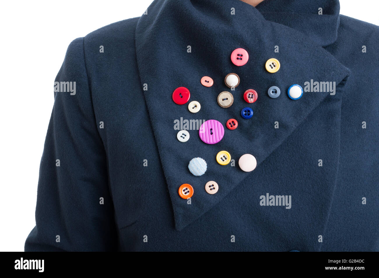 Closeup of creative handicraft with colored buttons stitched