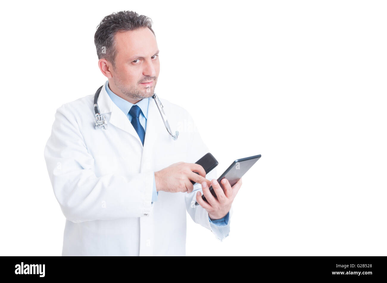 Smart and modern medic or doctor using tablet and phone isolated on white background - Stock Image