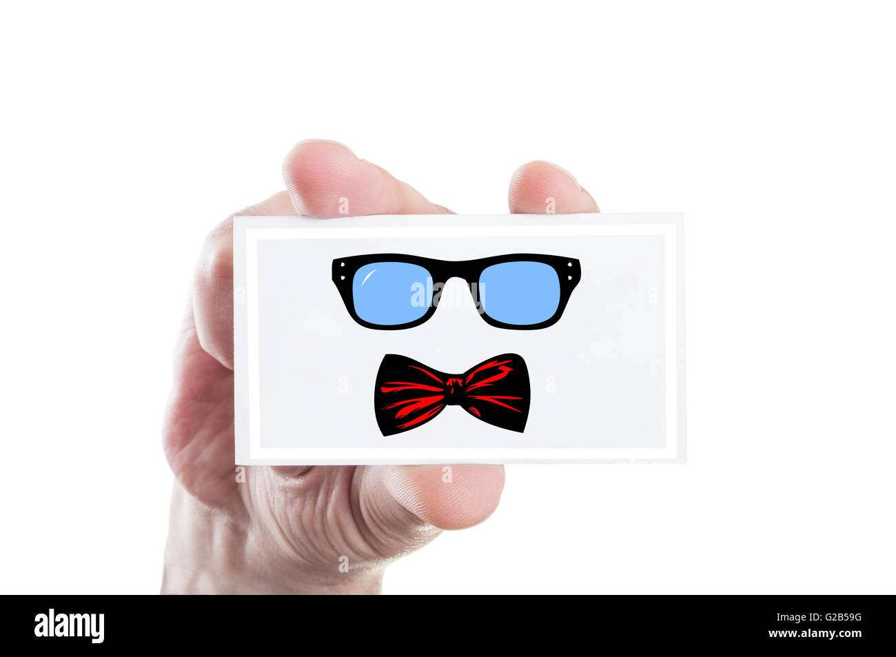 Hand holding hipster eyeglasses and bowtie illustration draw on a card - Stock Image