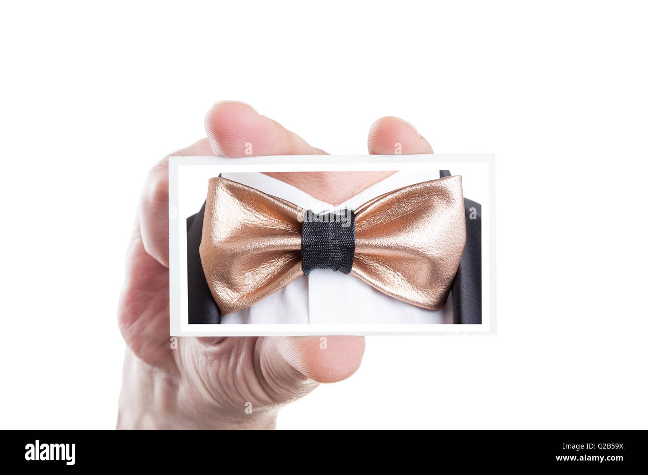 Hand holding card with golden leather bowtie picture as bow tie fashion concept Stock Photo