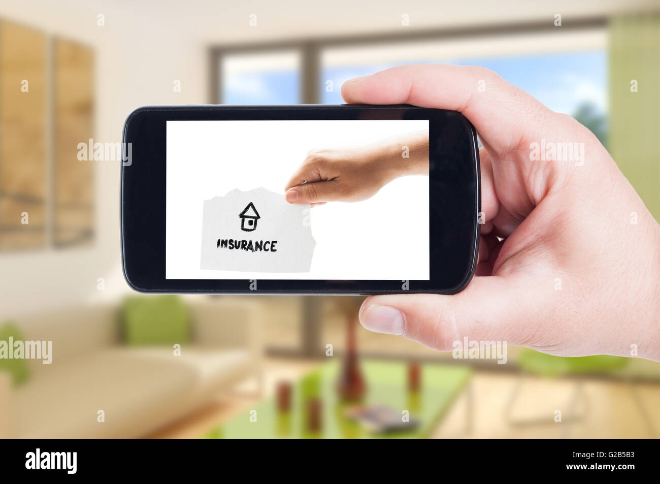 House insurance concept on smartphone display or cellphone screen - Stock Image