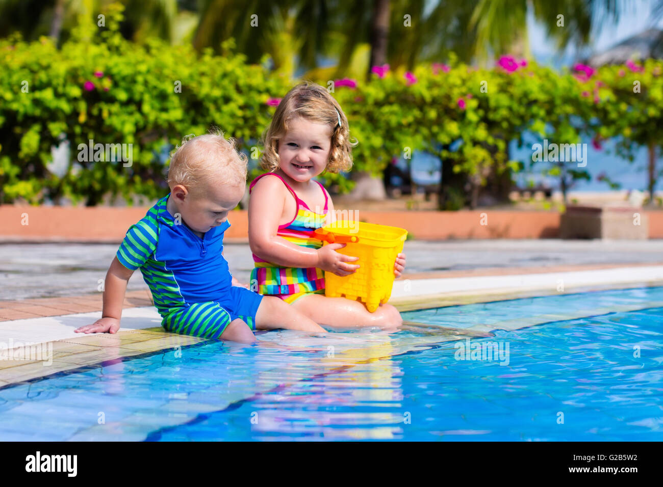 Girl And Boy Playing In Swimming Pool In Tropical Resort Child Stock Photo 104737614 Alamy