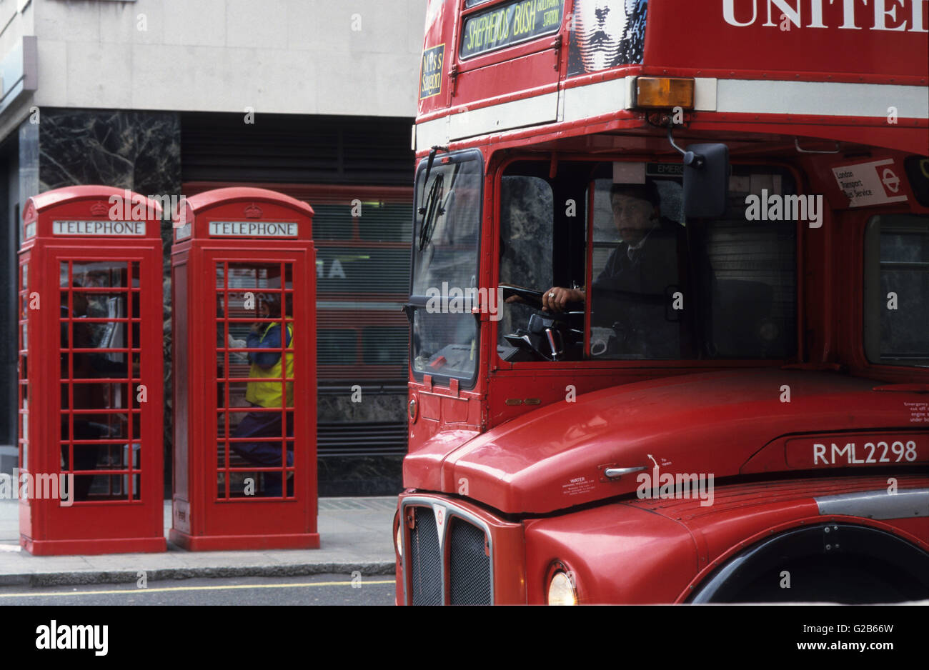 Great Britain London, red telephone cabin of british telecom and red double decker bus - Stock Image