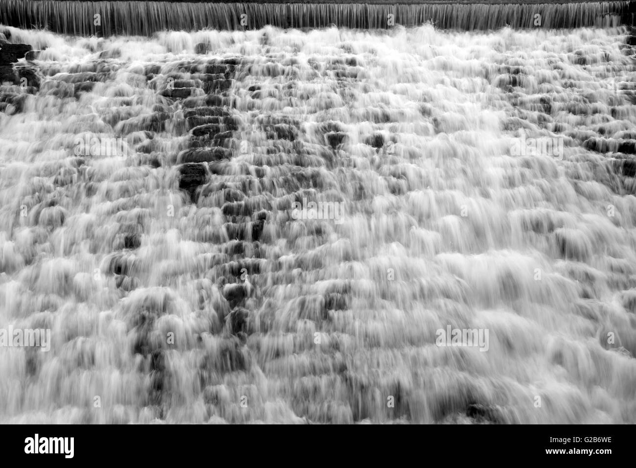 Weir on the River Rea, Shropshire, England, UK - Stock Image