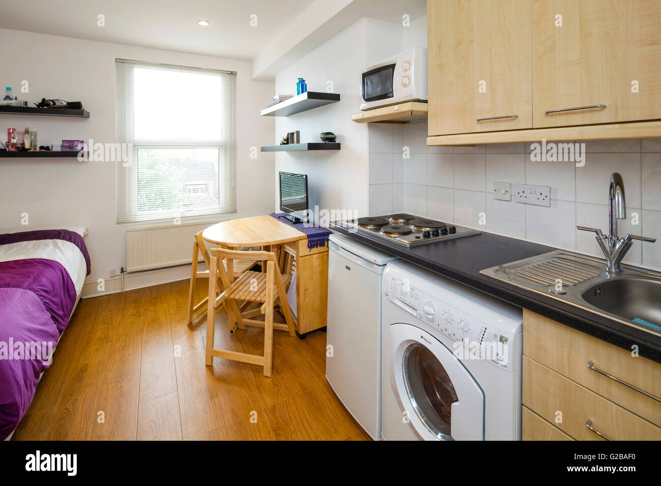 studio flat. View Of A Studio Flat With Wood Flooring And Small