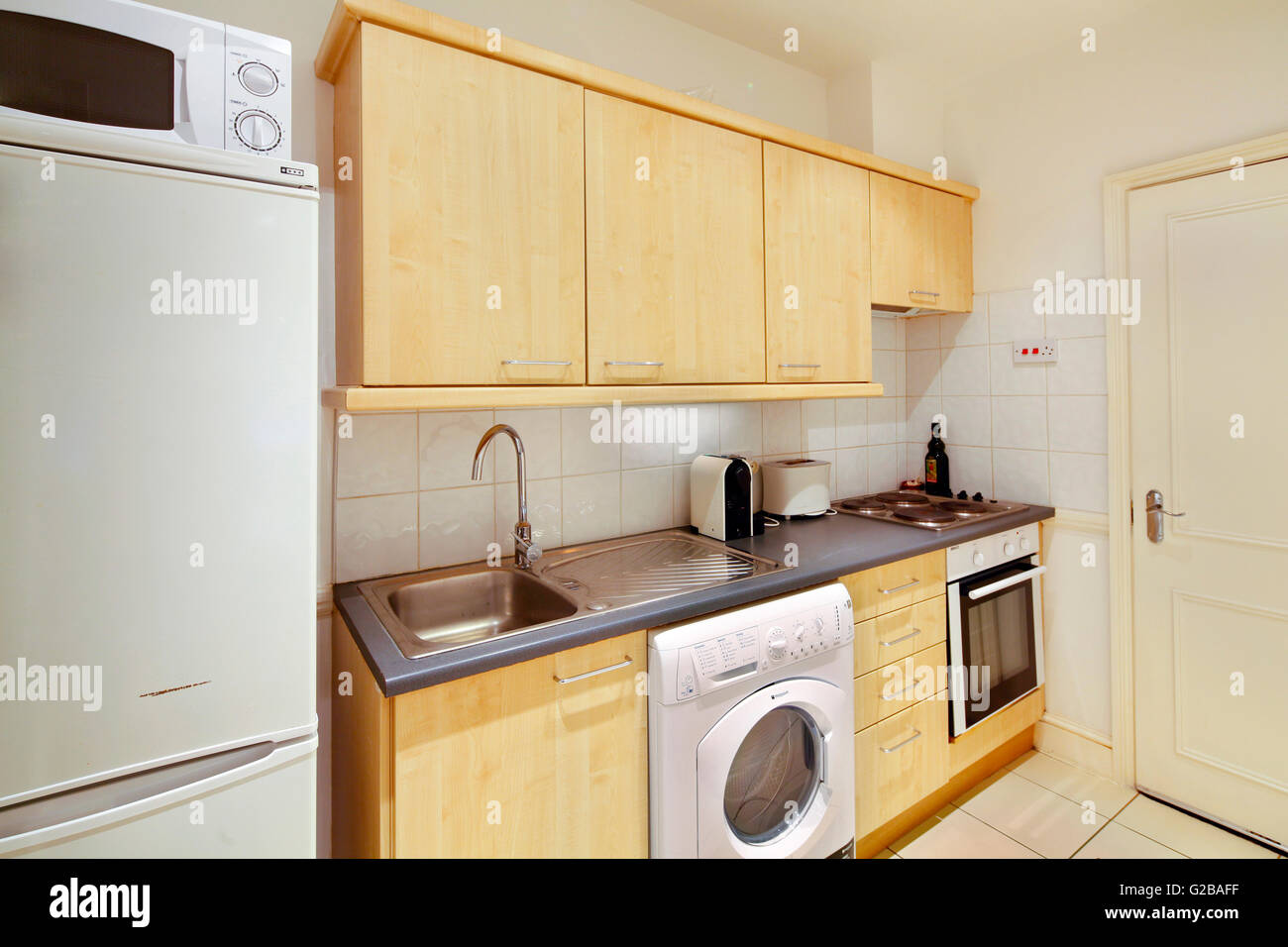 Harrington Gardens. View of an outdated worn kitchen. - Stock Image