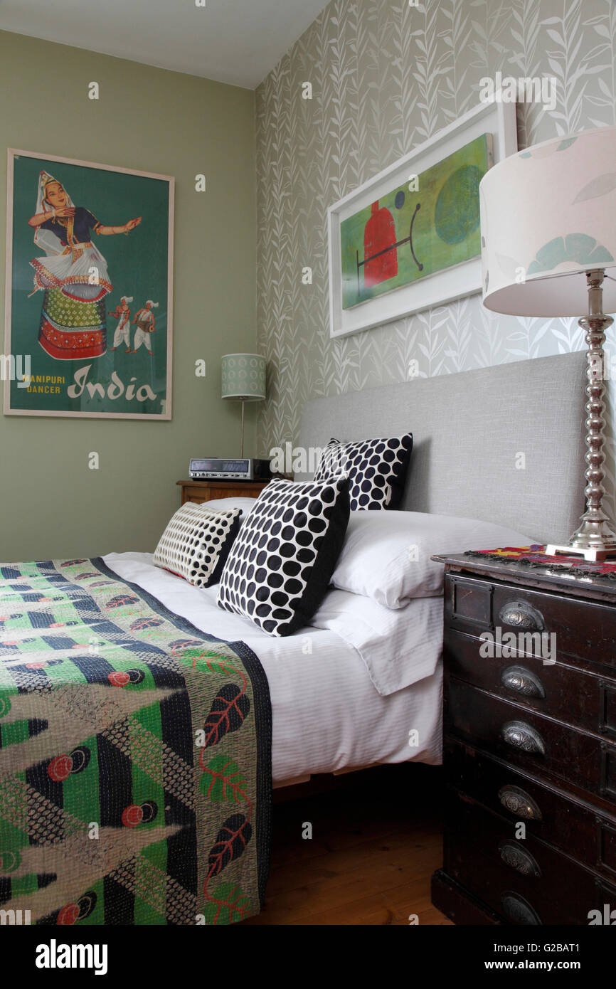 Indian Travel Poster And Abstract Art Above The Bed. Contemporary  Furnishings And Colourful Bedroom.