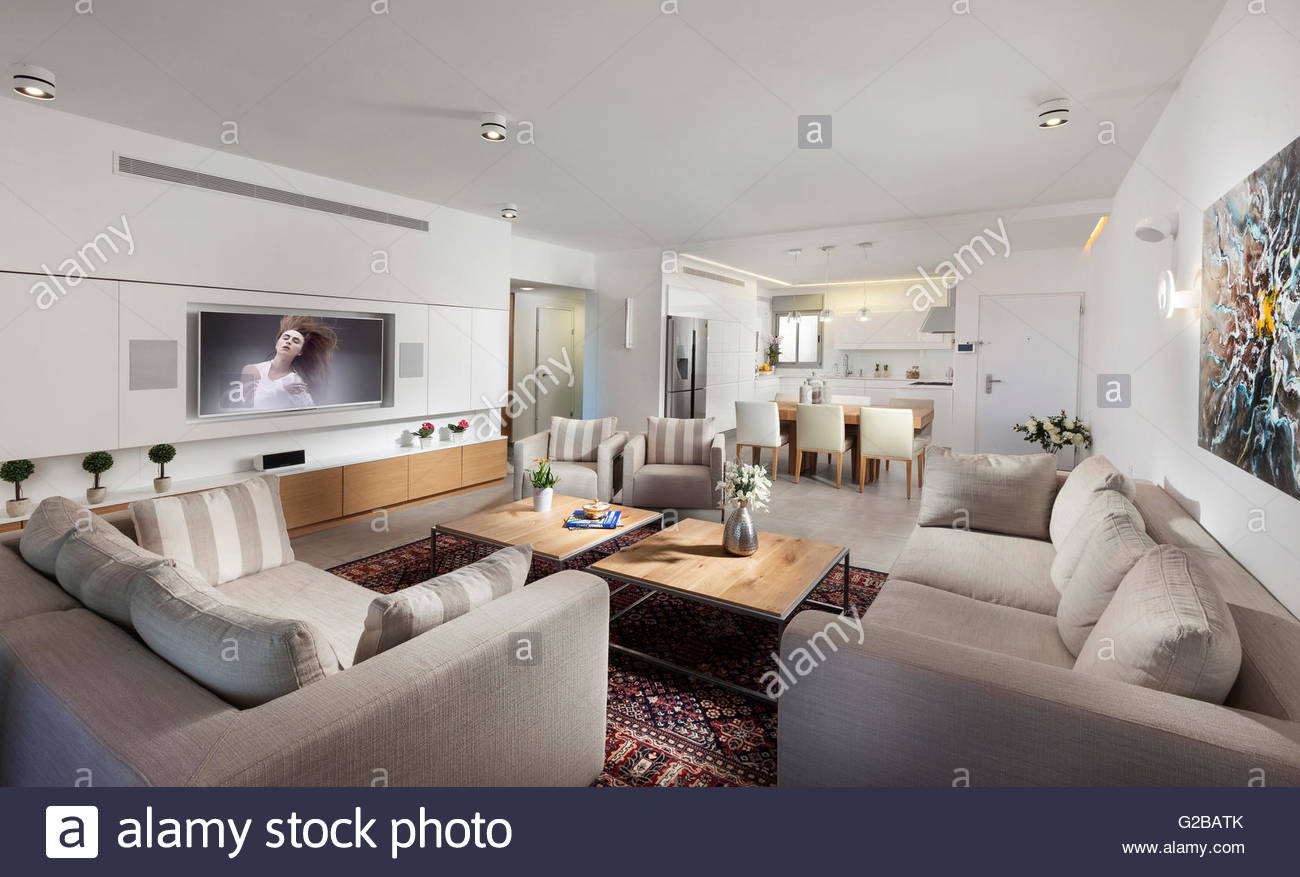 Modern Apartment, Shoham By Adi Aronov. Open Plan Living Room And Kitchen.  Contemporary Furniture And Neutral Tones. Prints And Flat Screen Tv On The  Wall.