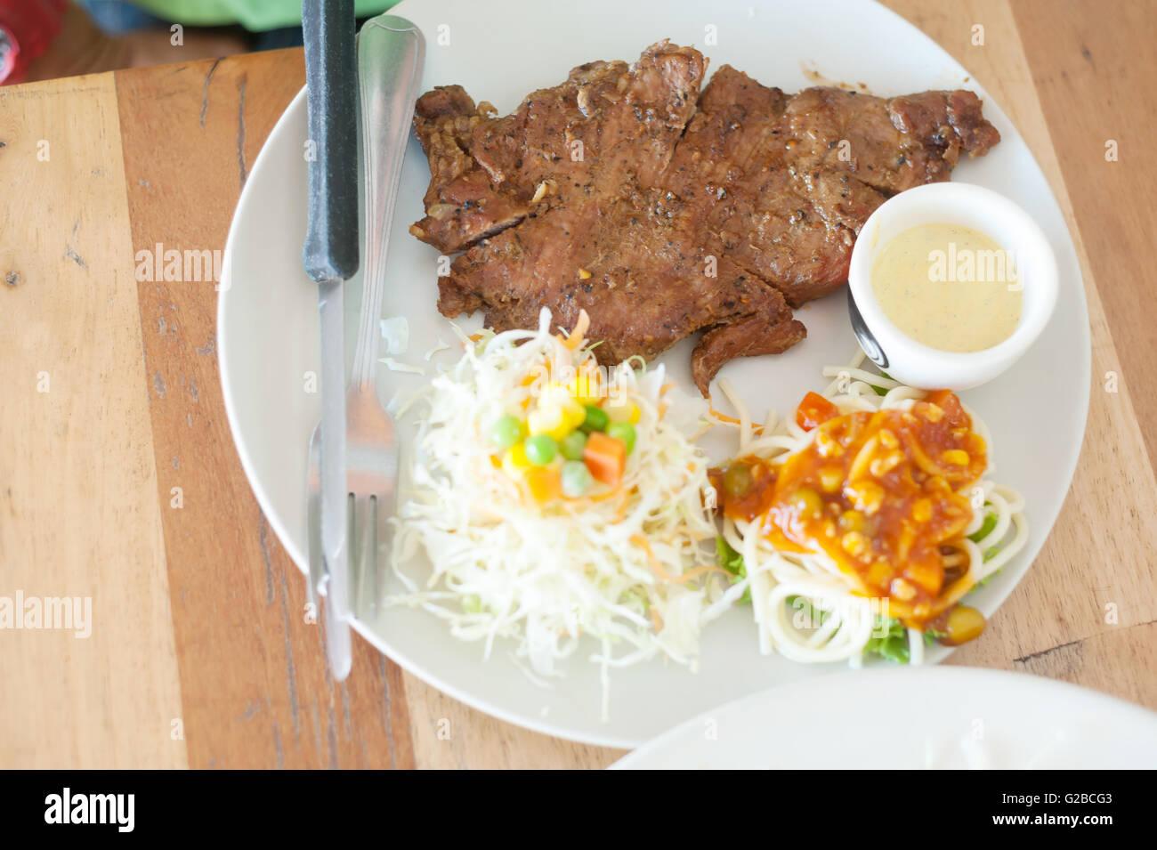 An steak in white disk soft light . - Stock Image