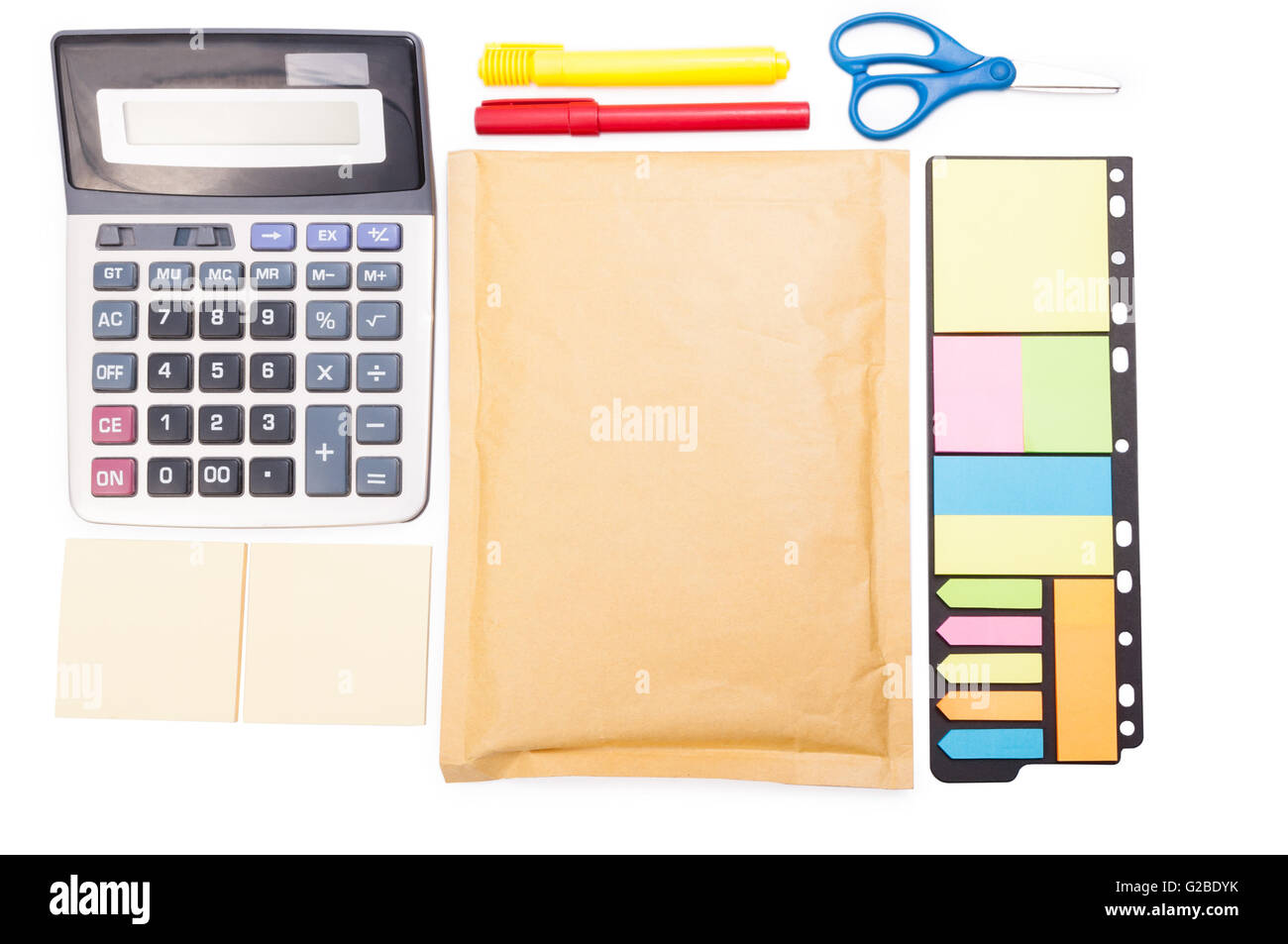 Organized business desk from upper view with paper notes, calculator, envelop and office tools on white background - Stock Image