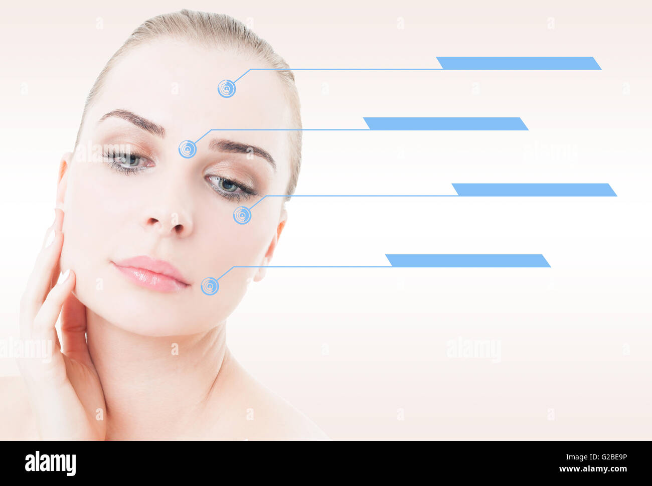 Female portrait with smooth skin and indicators on her face against pink studio background - Stock Image