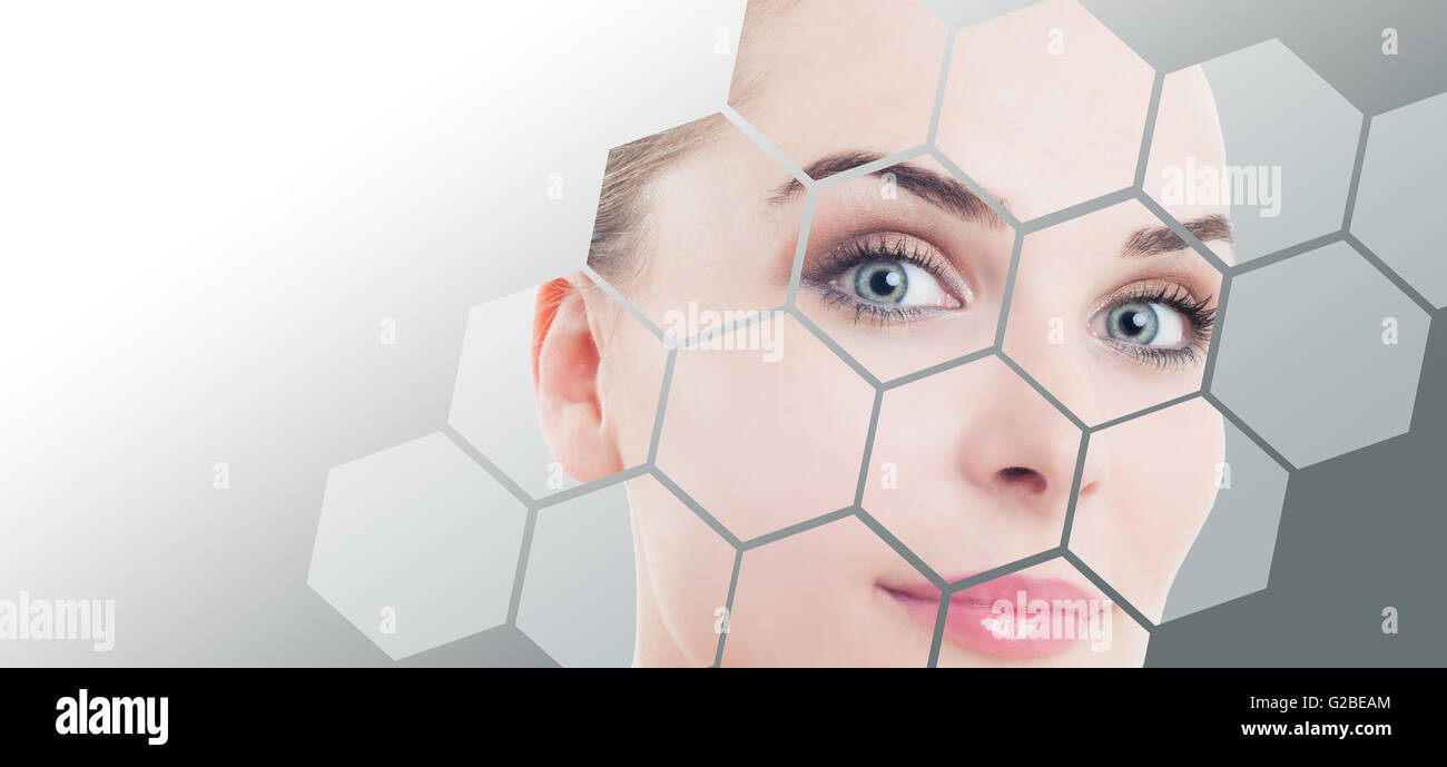 Close-up of woman perfect face with beauty correction and makeup against gray background gradient - Stock Image