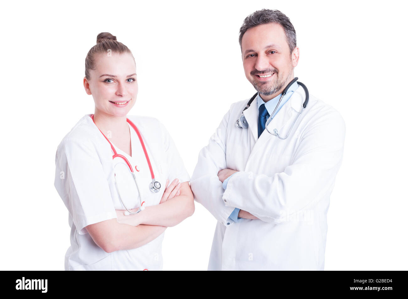 Smiling and confident young doctors in white uniform  working together as partnership and teamwork concept - Stock Image