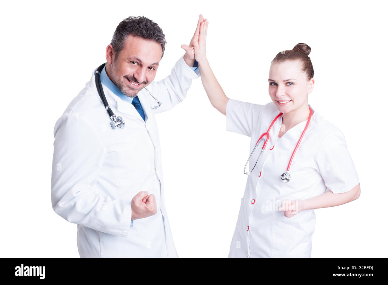 Happy team doctors give high five, smiling and celebrate success of working together isolated on white background - Stock Image
