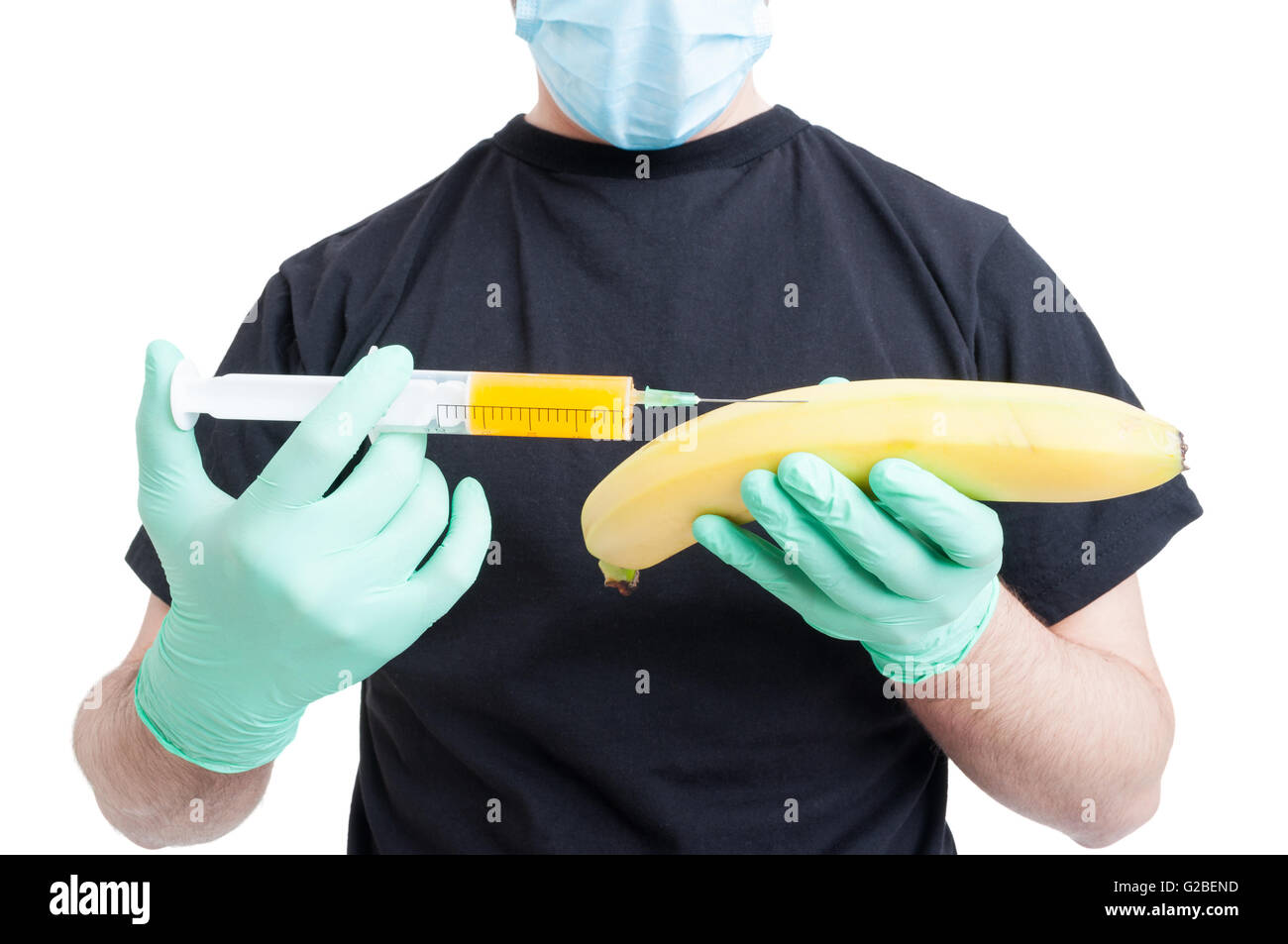 Genetically modified banana or fruit and syringe in male hands wearing blue gloves as artificial food concept isolated - Stock Image