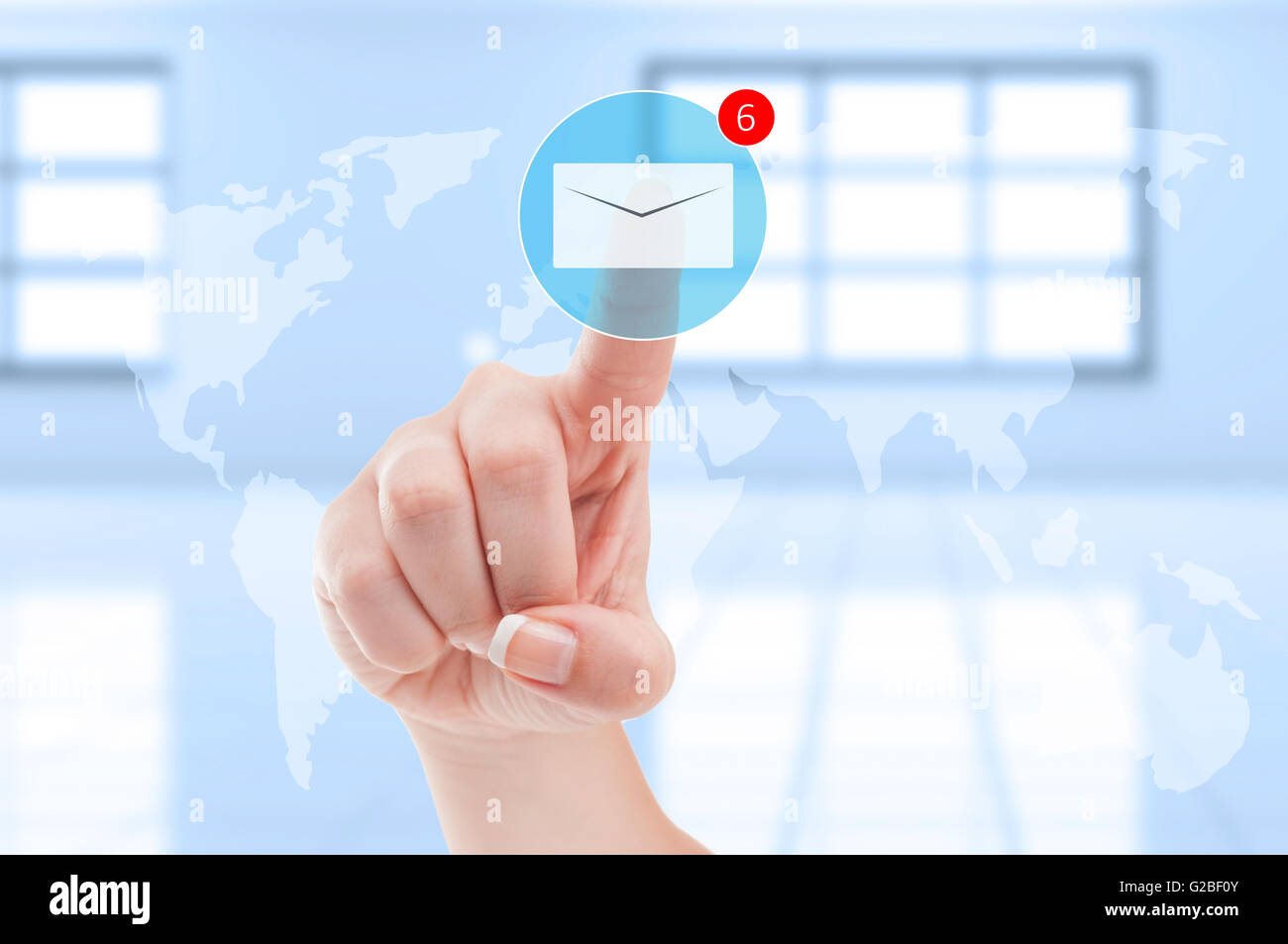 New emails inbox futuristic concept with finger pressing digital envelope on transparent digital display screen - Stock Image