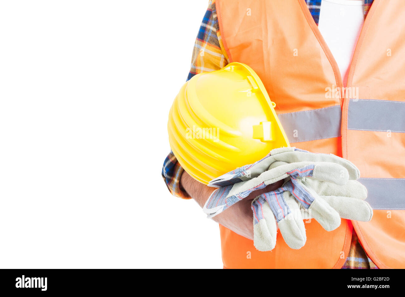 Concept of secure equipment with helmet, reflective vest and gloves in close-up isolated on white - Stock Image