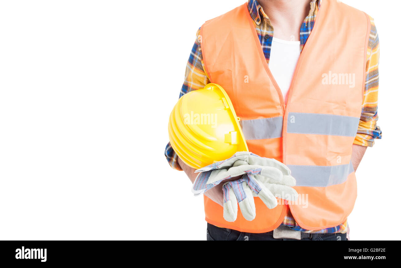 Closeup engineer holding helmet and wearing vest and gloves for safe constructions isolated on white background - Stock Image