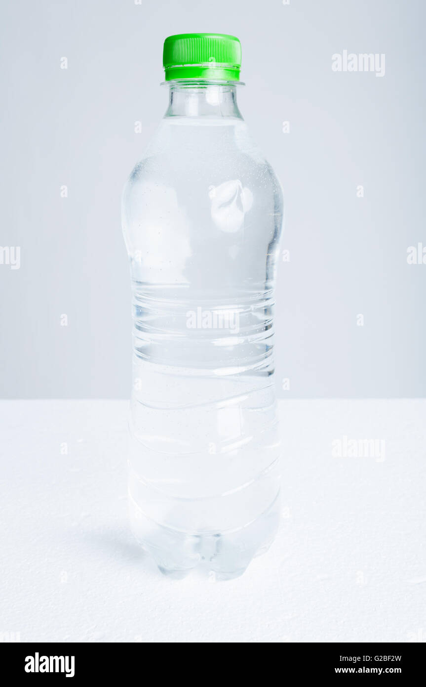 Plastic bottle of purified drinking water as hydration and refreshment concept isolated on white background - Stock Image