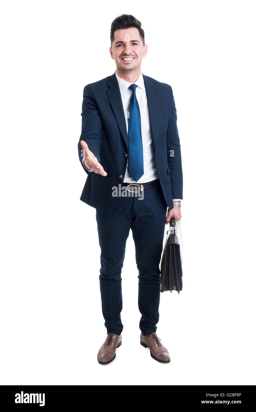 Confident trustworthy and friendly sales man offer handshake standing isolated on white background - Stock Image