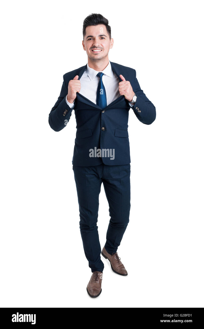 Powerful and confident young businessman opening his suit jacket as superhero metaphor - Stock Image
