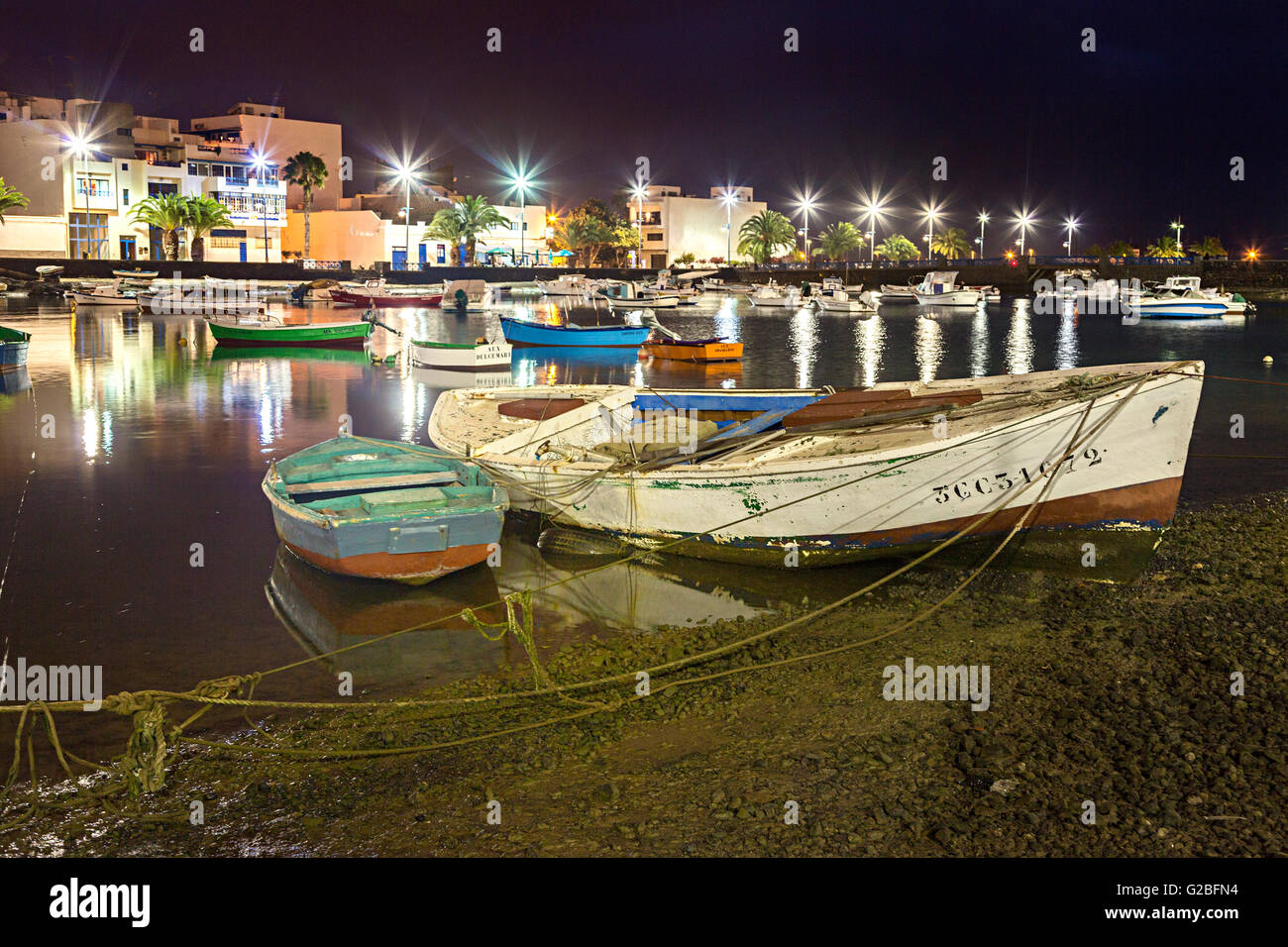 Boats moored in harbour at dusk, Arrecife, Lanzarote, Canary Islands, Spain - Stock Image