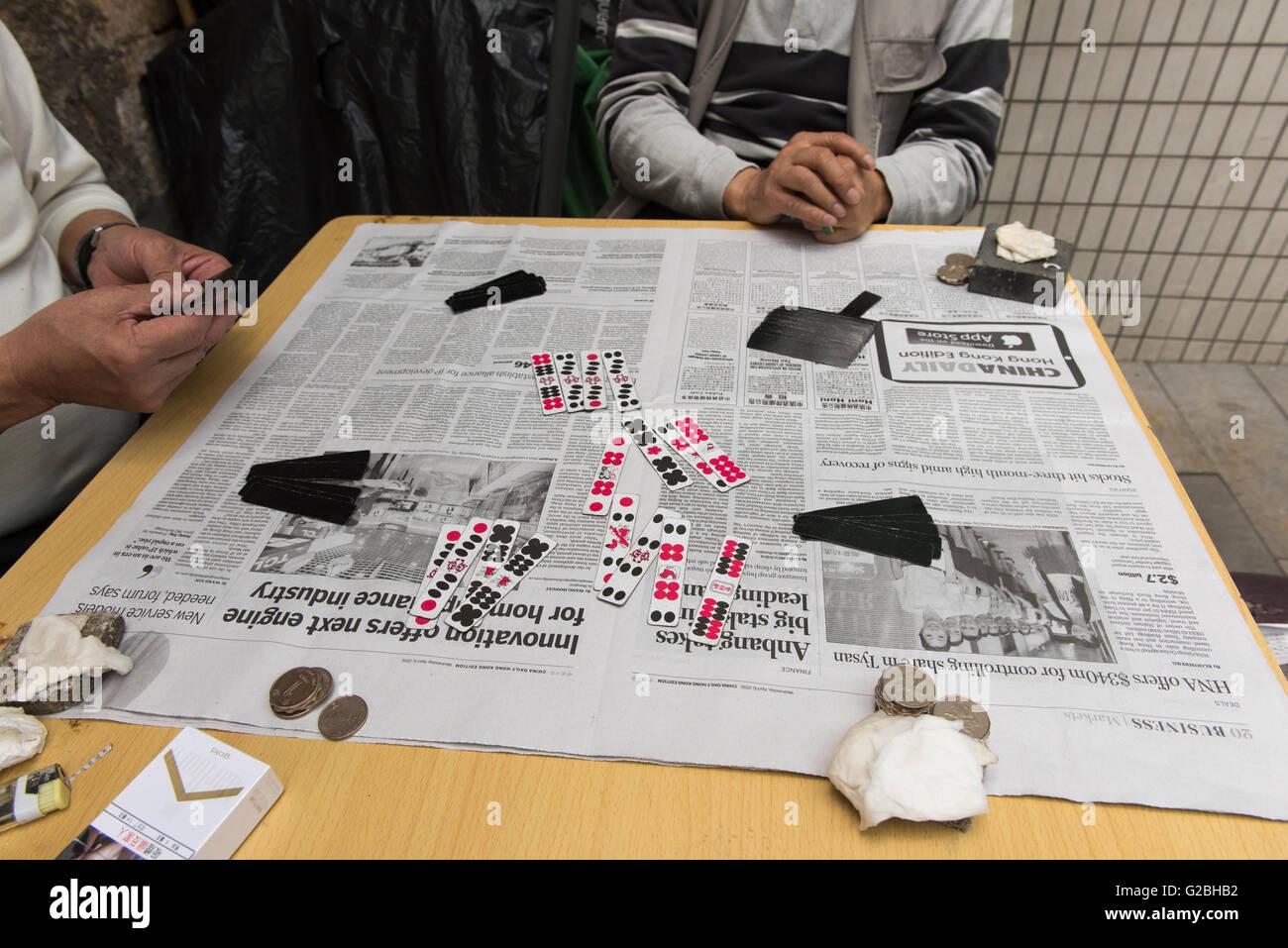 Playing a game of Domino Cards, Hong Kong China - Stock Image