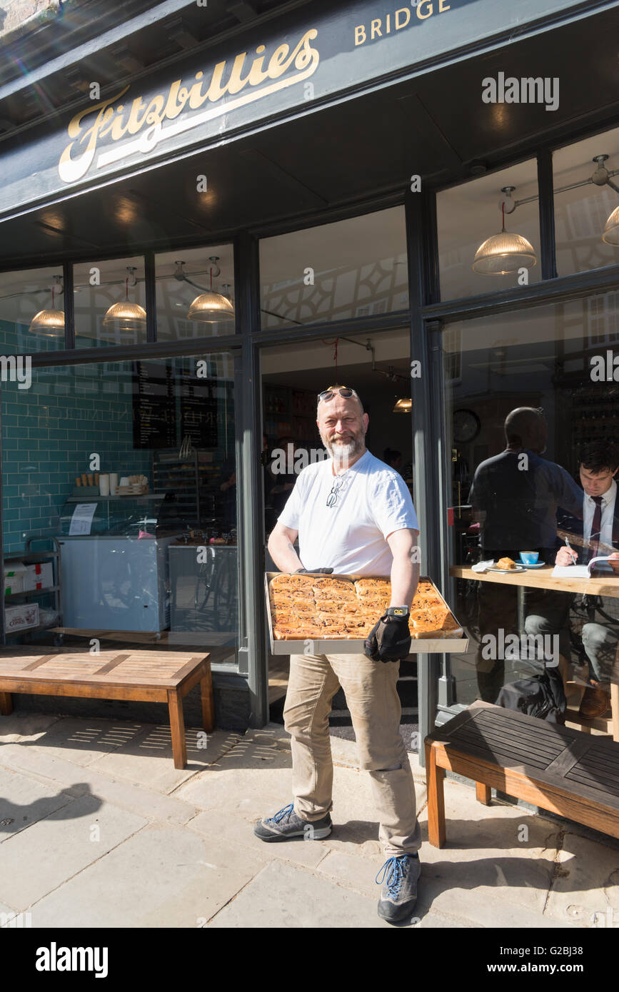 Tim Hayward the owner of the new Fitzbillies cafe and restaurant Cambridge UK holding a tray of chelsea buns Stock Photo