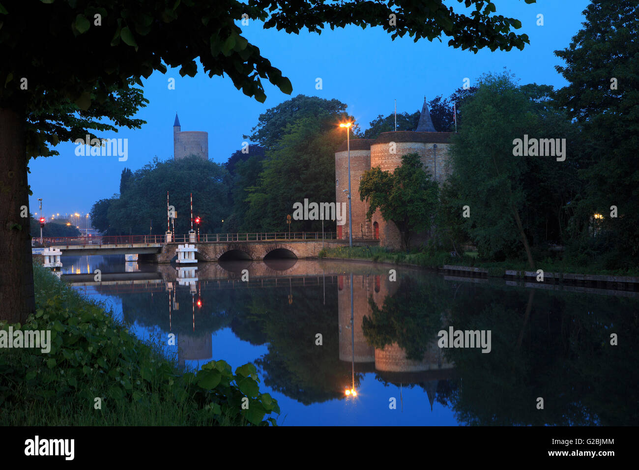 The Gate of Ghent - Gentpoort (1400) and Water tower (1925) in Bruges, Belgium Stock Photo