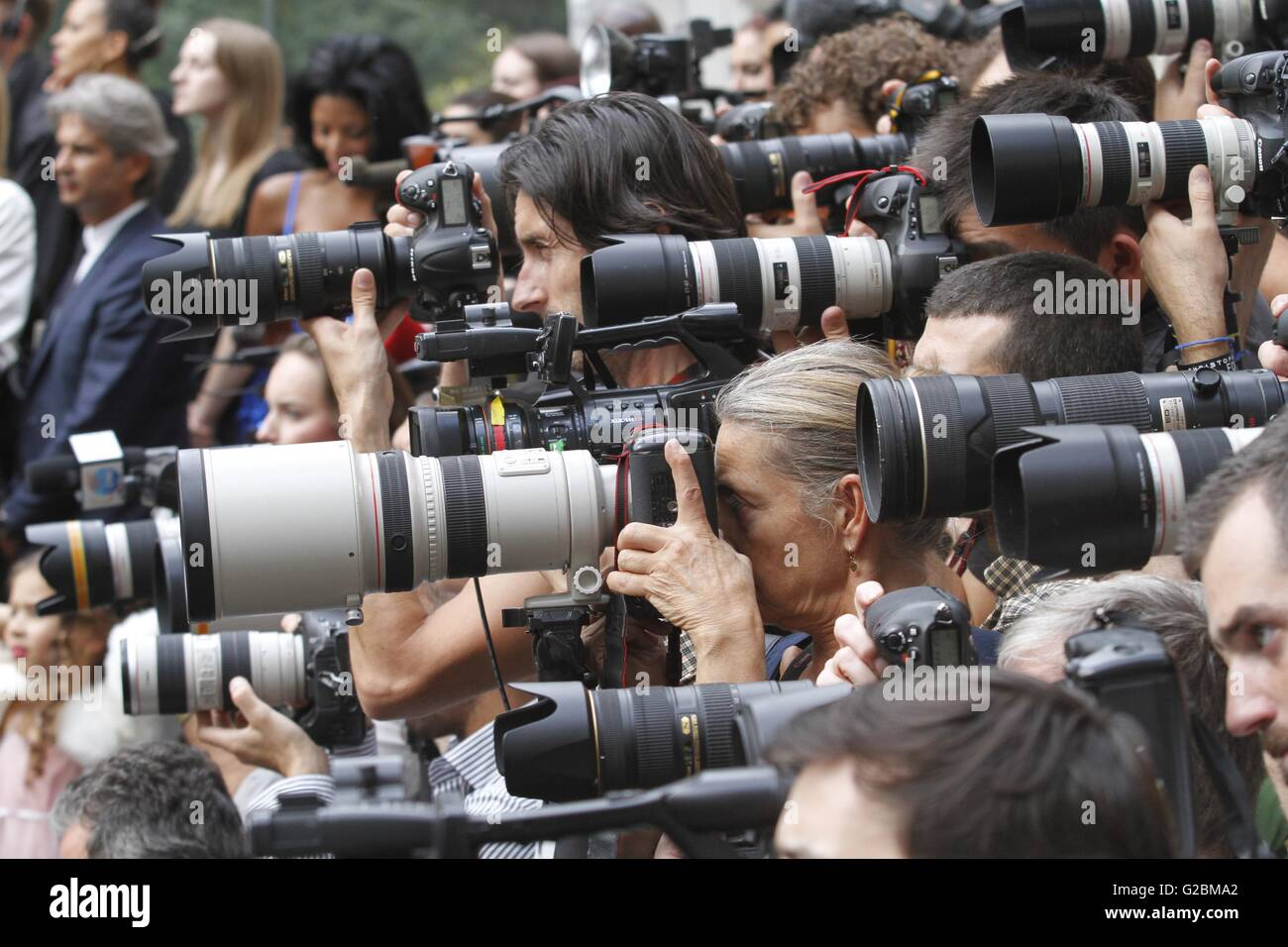 Photographers crammed into a pen at a Burberry fashion show during London Fashion Week. Stock Photo