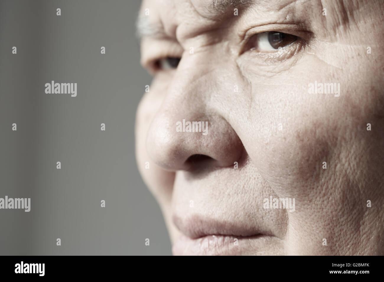 Face of elderly man looking at camera. Horizontal photo - Stock Image