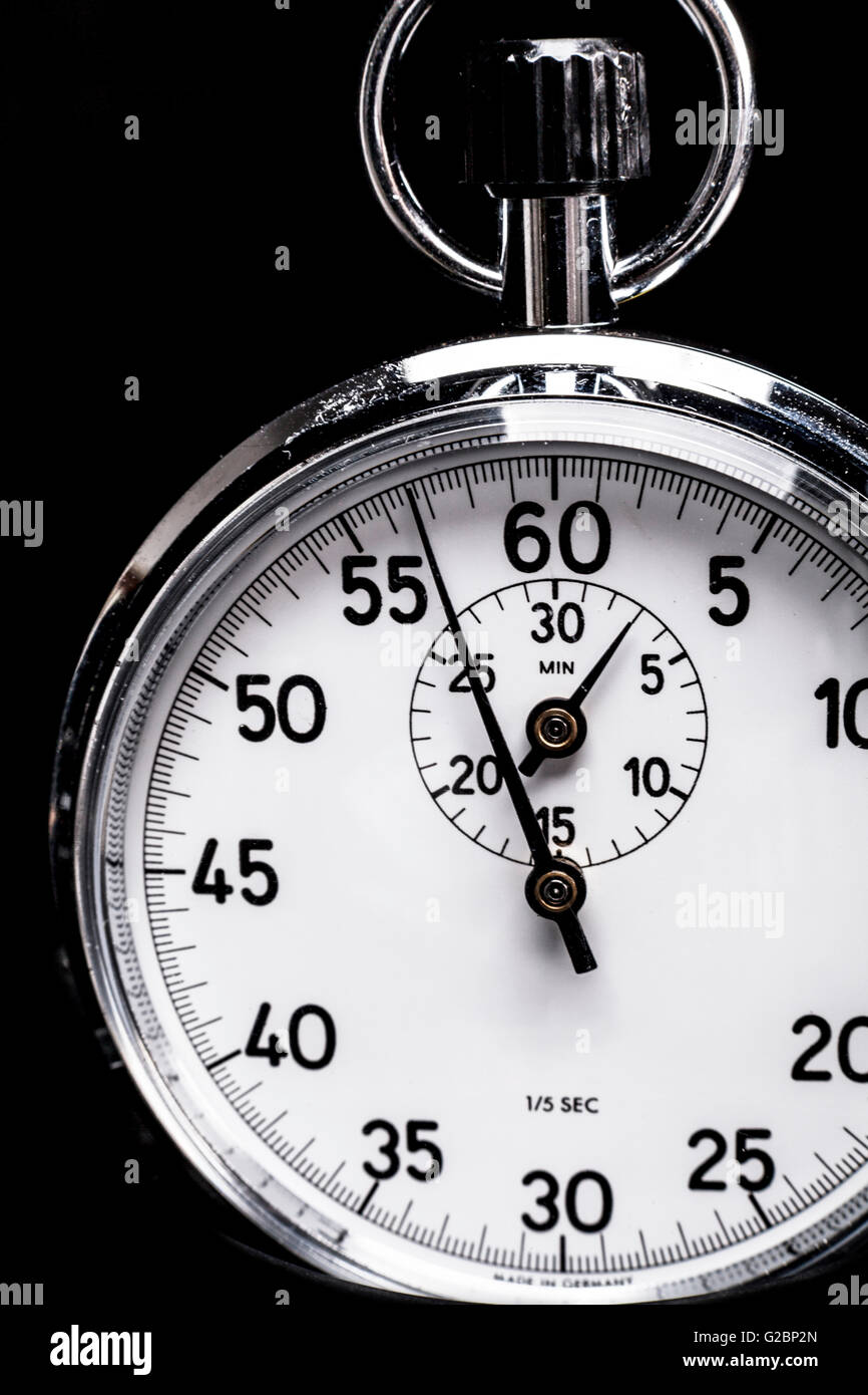 Silver chronometer object isolated on black background - Stock Image