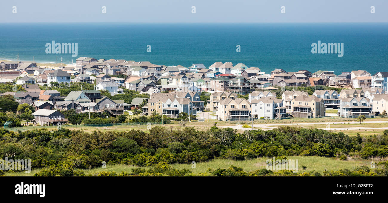 View of ticky tacky, oversized houses in over built beach town of Buxton on Hatteras Island, Outer Banks, North - Stock Image