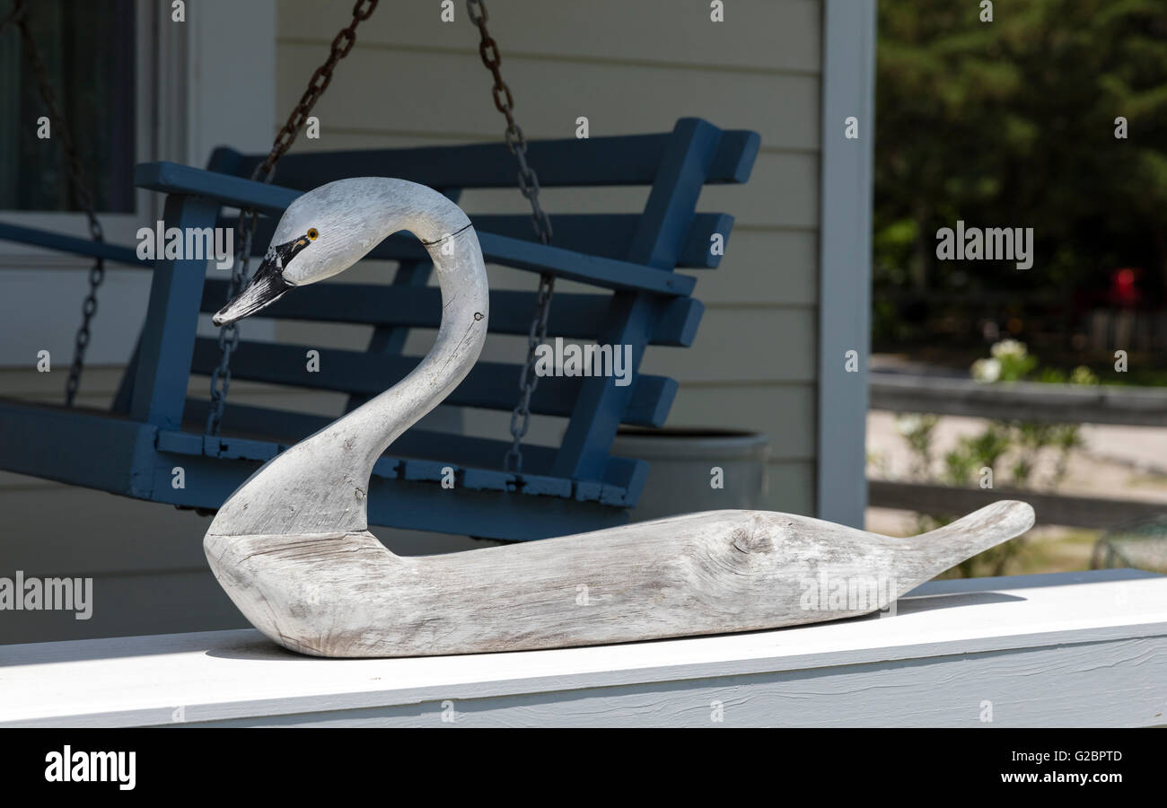 Carved swan on porch, town of Ocracoke, Ocracoke Island, Outer Banks, North Carolina, USA - Stock Image