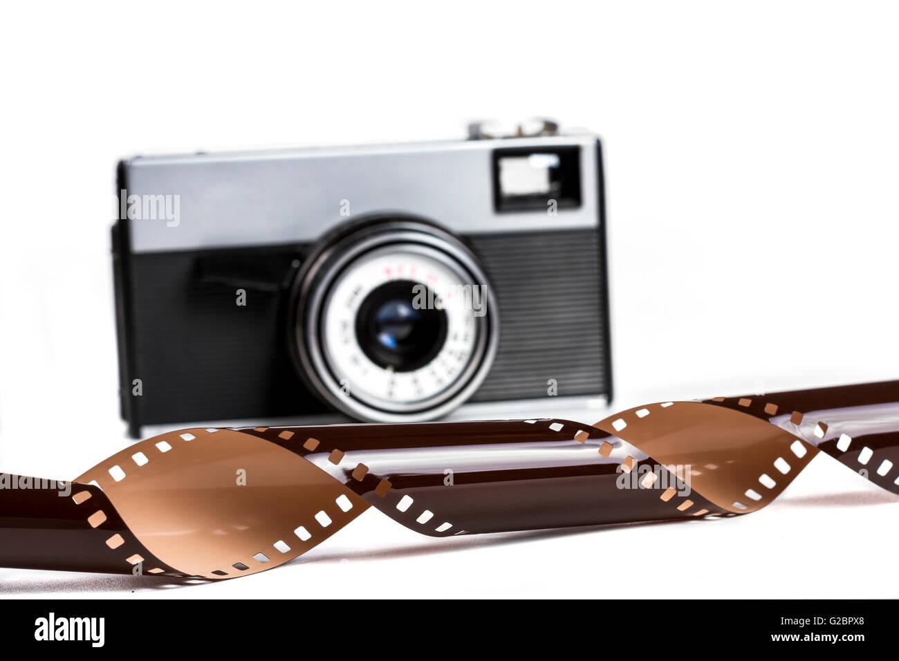 Old Film Camera Isolated on White Background - Stock Image