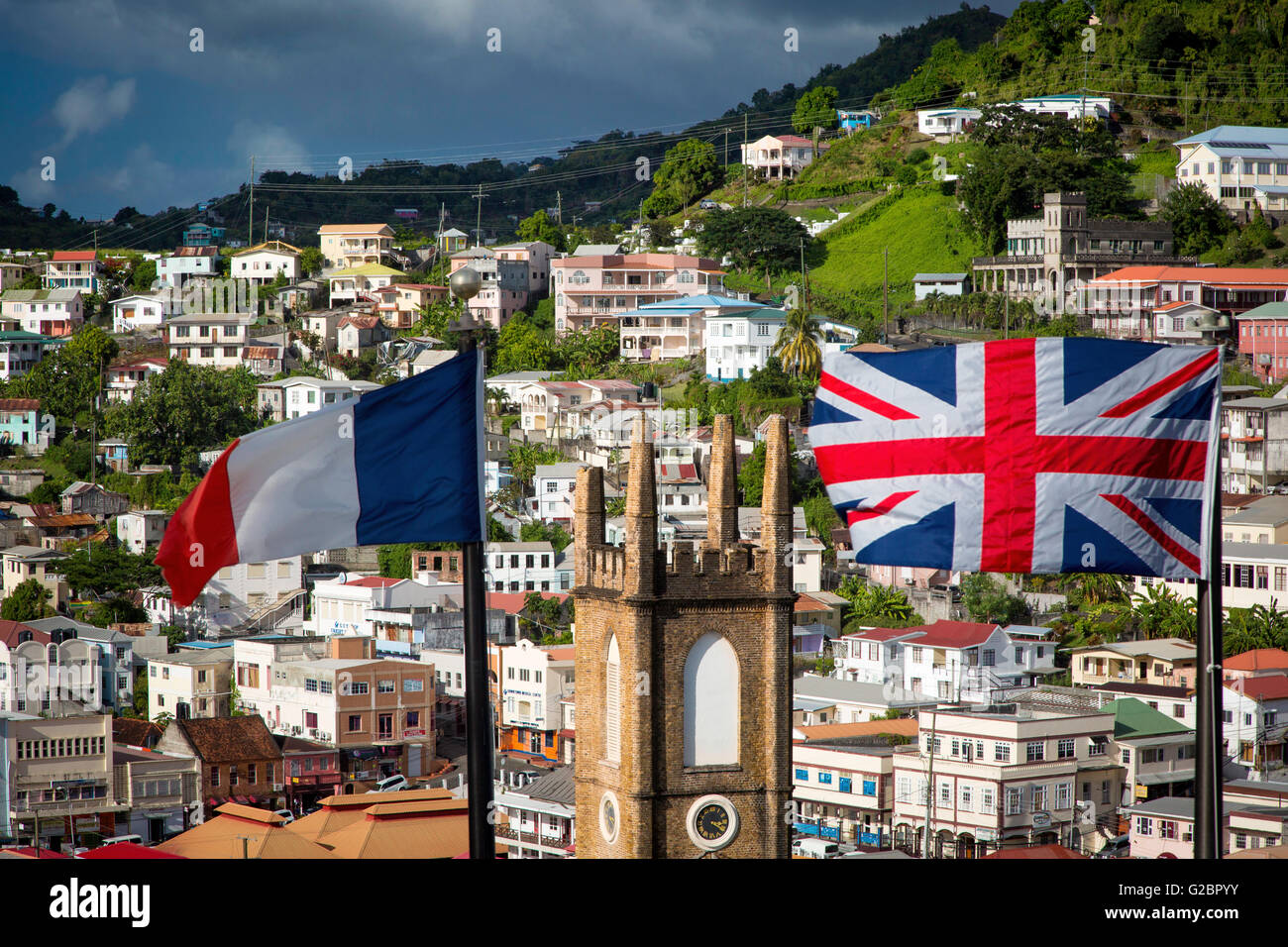 British and French flags fly from Fort George over St Andrews Presbyterian Church and town of St. Georges, Grenada Stock Photo