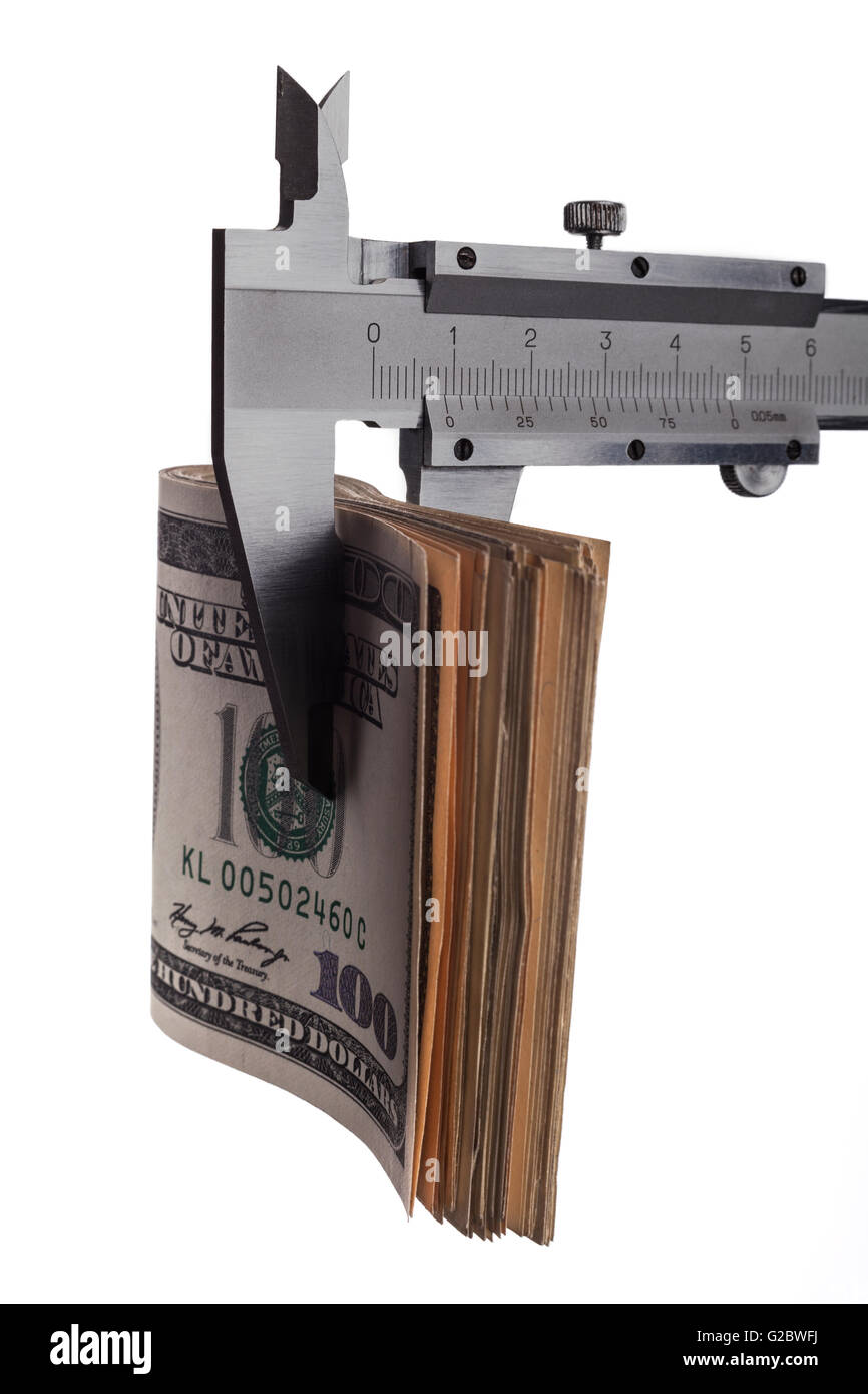 Measuring dollar banknotes with calliper isolated on white background - Stock Image