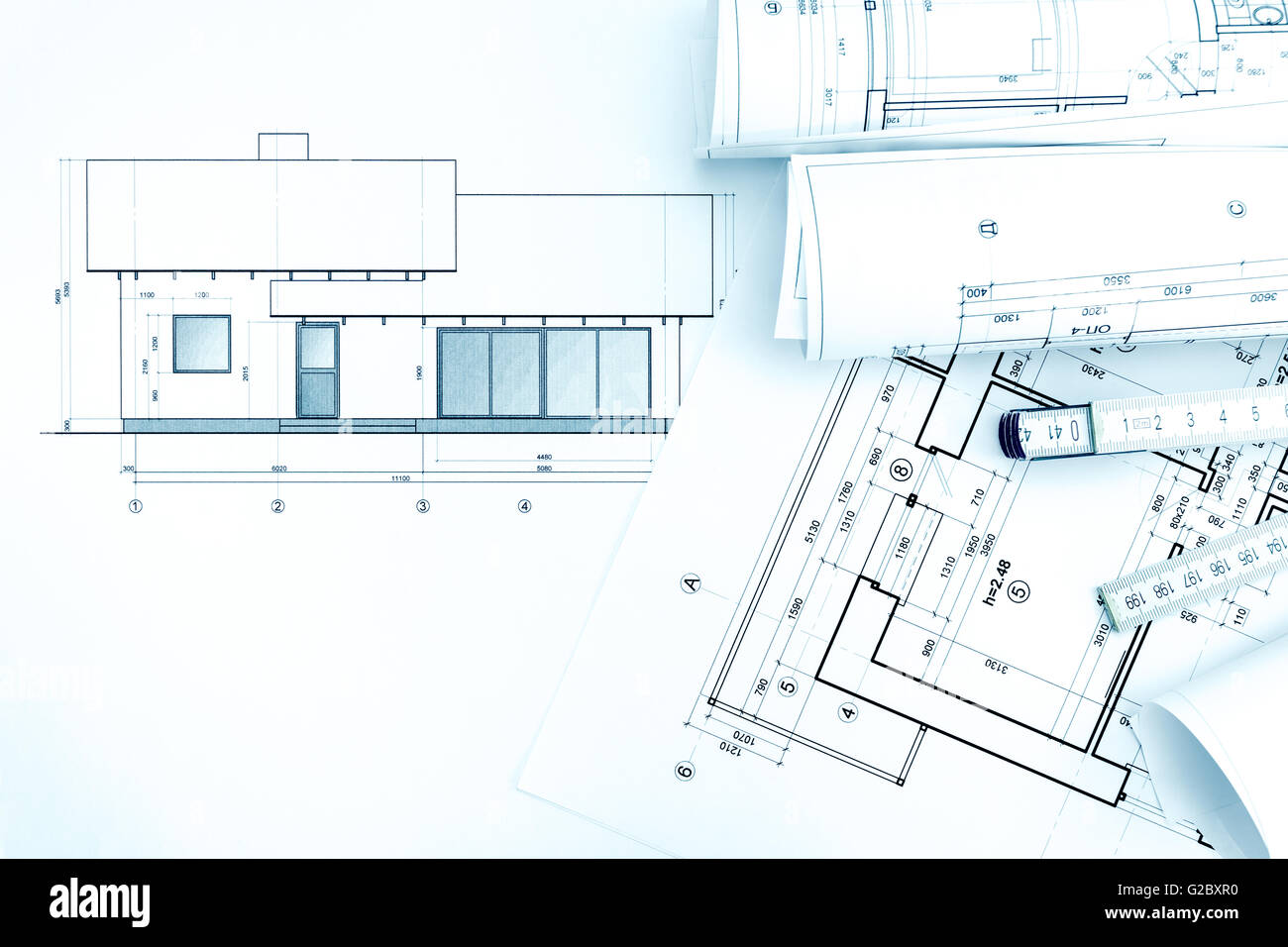 Home plans and blueprint rolls with folding rule architects stock home plans and blueprint rolls with folding rule architects workspace malvernweather Images