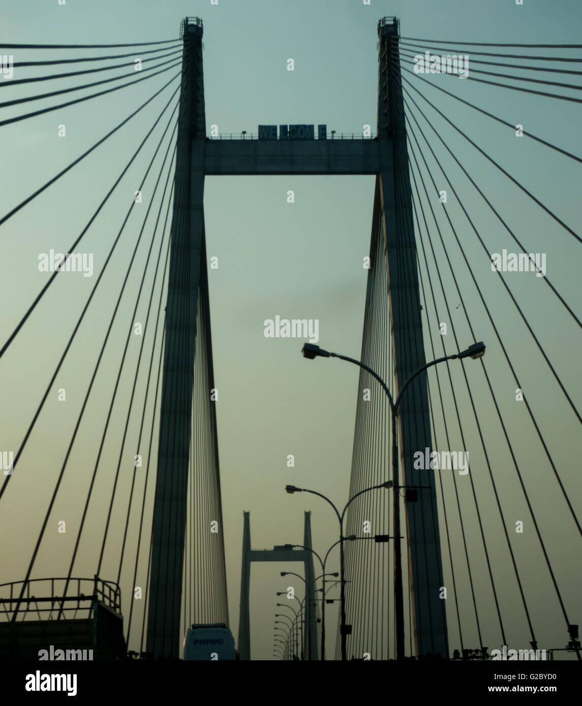 Looking up at the engineering marvel of Vidyasagar Setu (Second Howrah Bridge). A landmark suspension bridge in - Stock Image