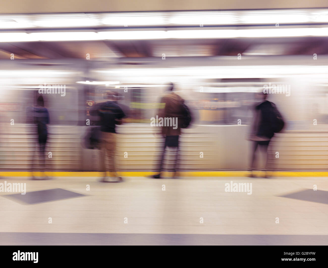People standing on a subway platform waiting for the arriving train, Toronto, Ontario Province, Canada - Stock Image