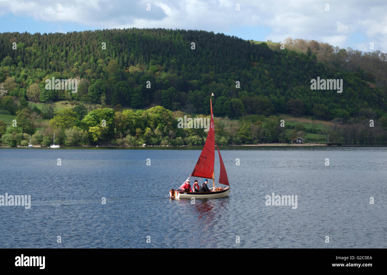 Ullswater (in the Lake District), Cumbria, UK. A sailing dinghy on the lake in early summer - Stock Image
