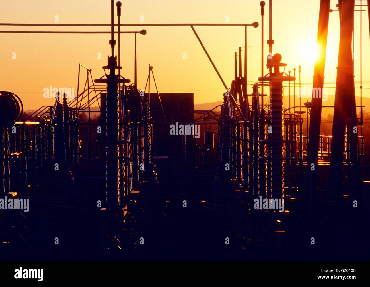 Electrical transmission yard at sunset, Limerick Nuclear Power Plant, Limerick, Pennsylvania, USA - Stock Image