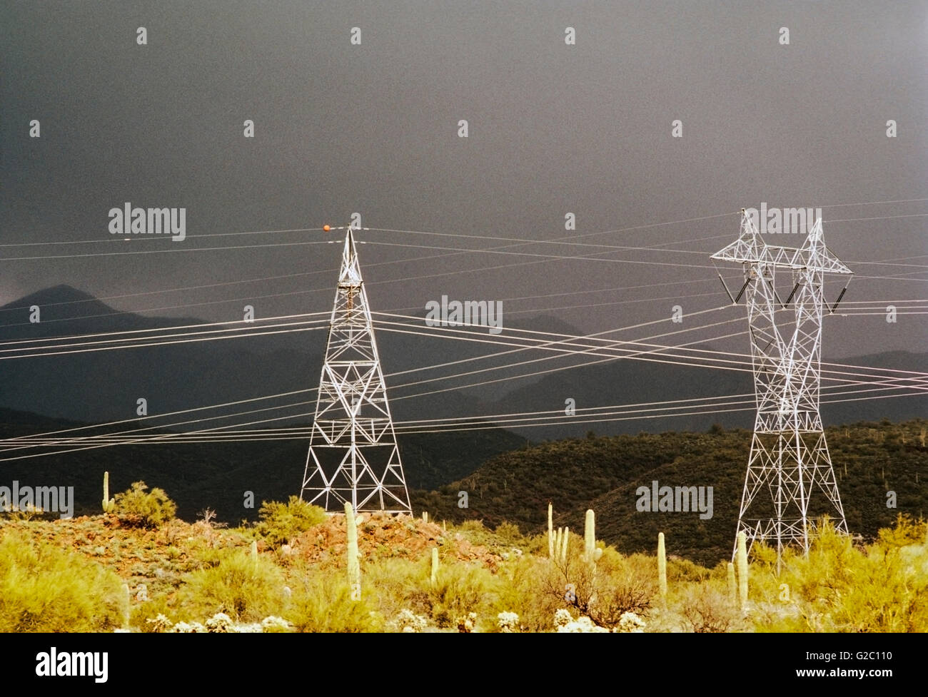 Electrical transmission lines and towers with a dramatic storm sky in the desert north of Phoenix, Arizona, USA - Stock Image