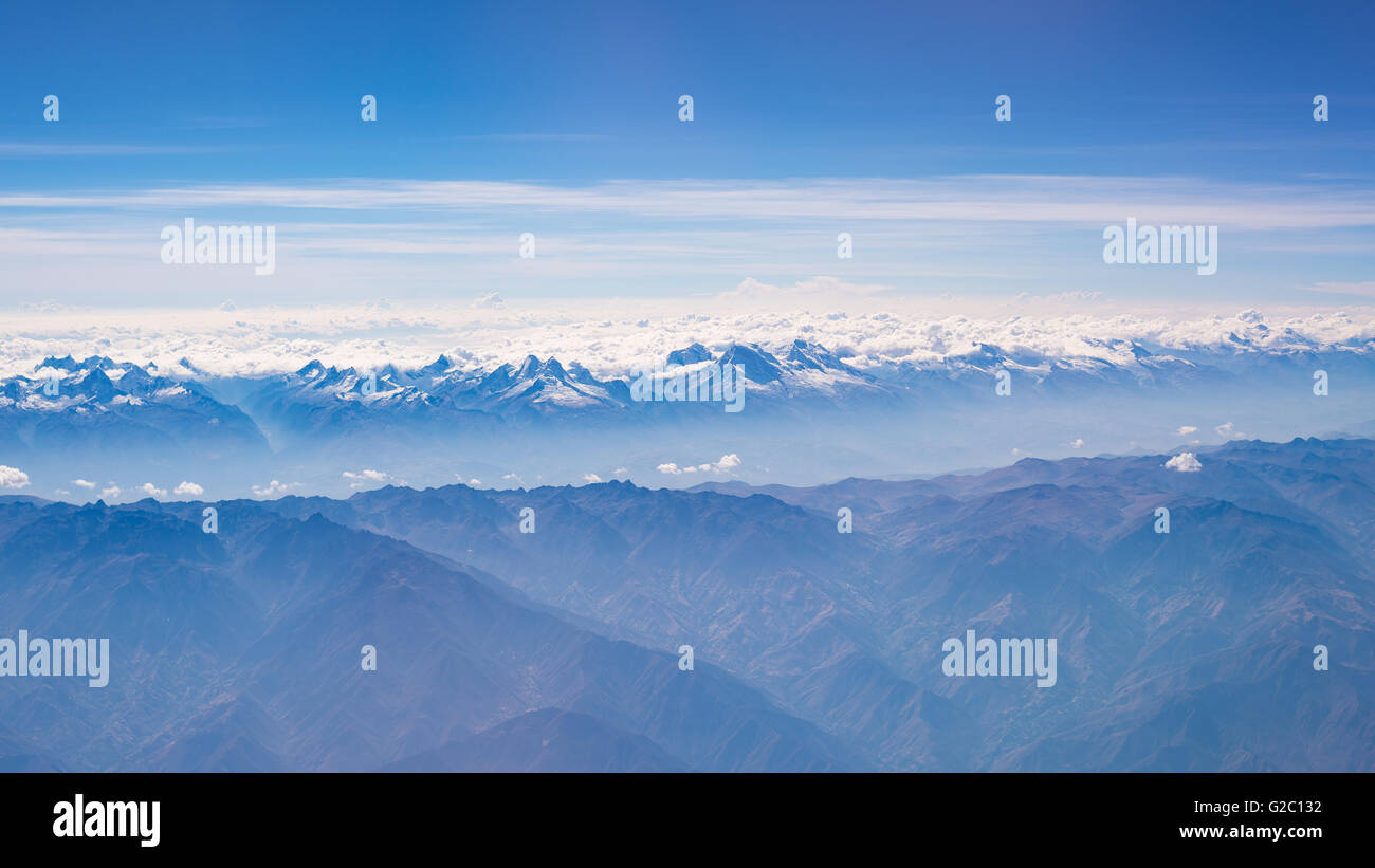 Aerial view of the Peruvian Andes, shot from aeroplane. High altitude mountain range and glaciers. Expansive view. - Stock Image