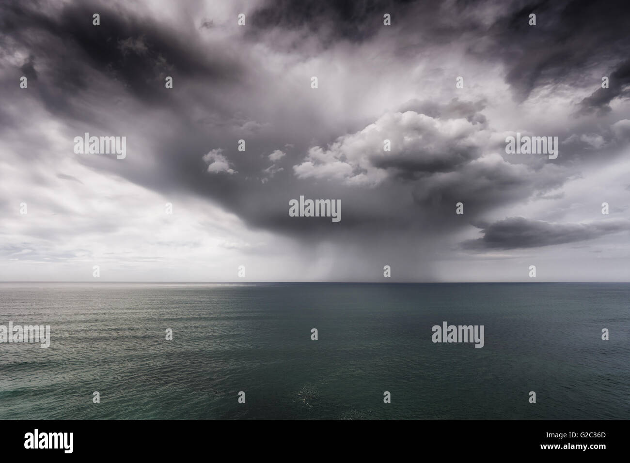 rain and stormy cloud on the sea - Stock Image