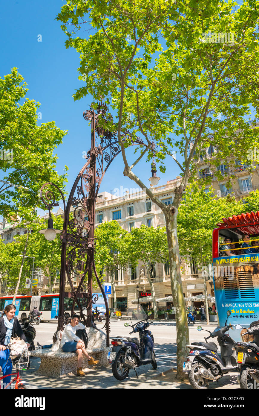 Spain Catalonia Barcelona Eixample Passeig de Gracia ornate Gaudi style combined bench seat & street standard - Stock Image