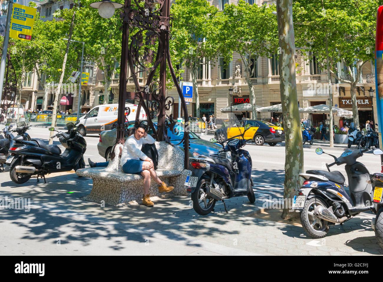 Spain Catalonia Barcelona Eixample Passeig de Gracia ornate Gaudi style combined bench seat & street standard - Stock Image