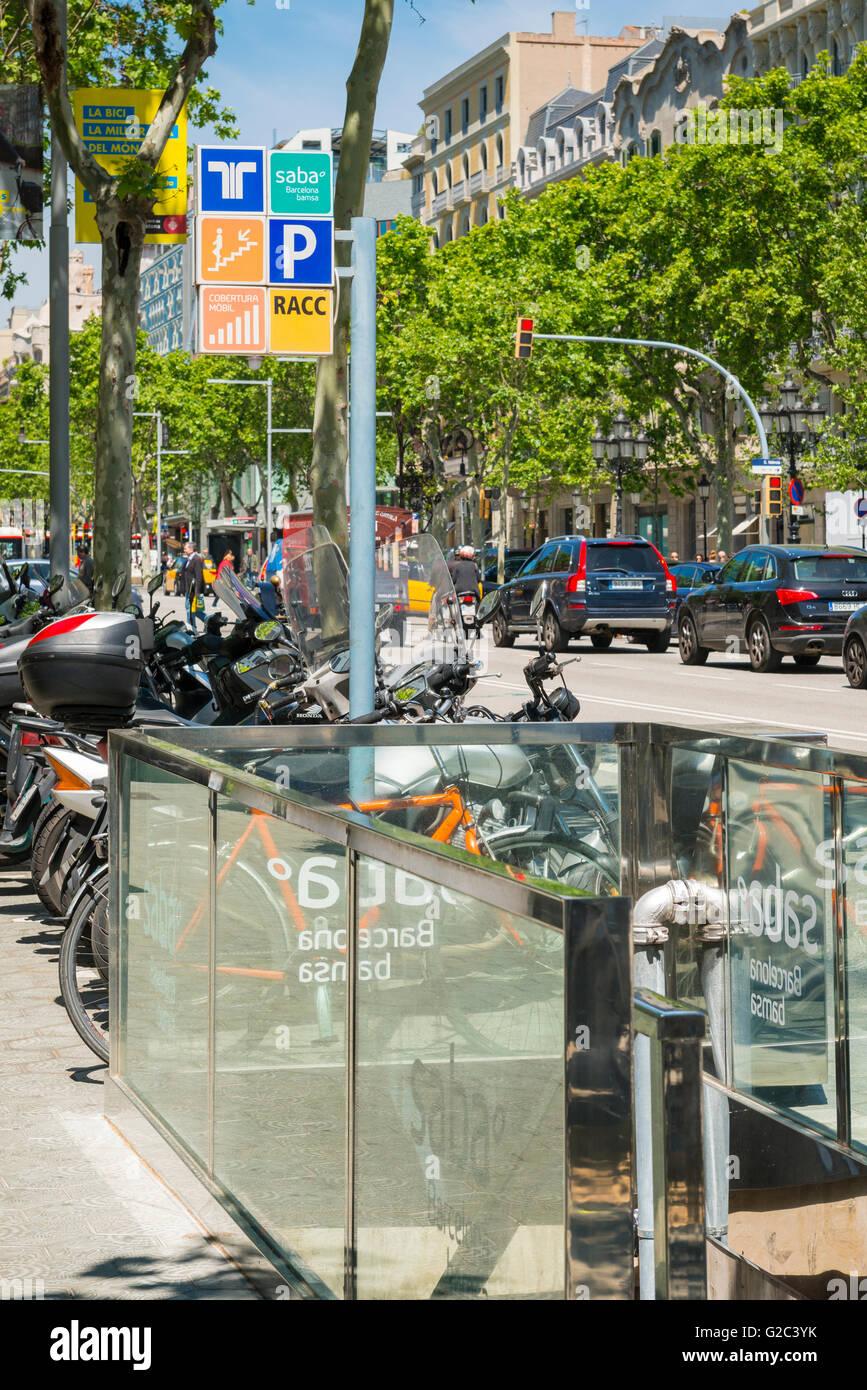 Spain Catalonia Barcelona Eixample Passeig de Gracia Metro subway underground station entrance motor bike cycle - Stock Image