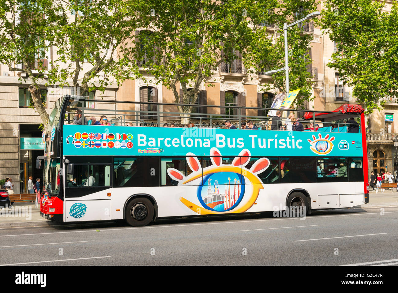 Spain Catalonia Eixample Passeig de Gracia Barcelona Bus Turistic tourist double decker open top - Stock Image
